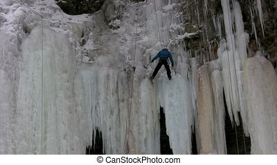 Repel - Ice climber repels down cliff