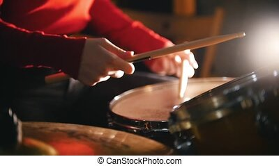 Repetition. Girl playing drums. Close up - Repetition. Girl...