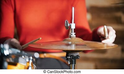 Repetition. Girl playing drums. Hi-hat close up. Slow motion