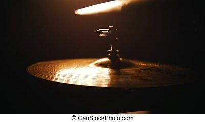 Repetition. Studio light on drumkit. playing rythm on raid, slowmotion