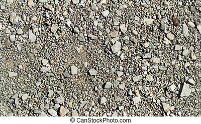 Repetitive pattern stones and gravel - Repetitive pattern of...