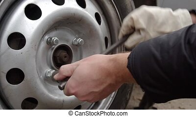 replacement wheels on the car on the road.