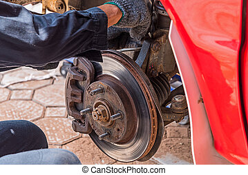 Replacing brakes.