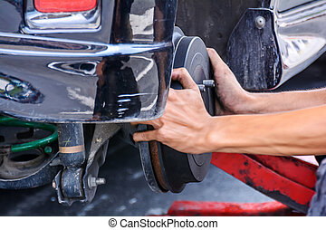 Replacing brakes vehicle - Mechanic technician worker...