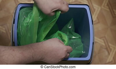 Replacing garbage bag in kitchen trash can. Modern tall...