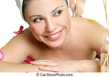 Replenish your body and soul at a day spa - A woman treats...