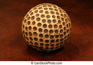 Replica Golf Ball - Close up of a replica of an old golf...