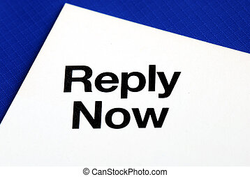 """""""Reply Now"""" from a business reply postcard isolated on blue"""