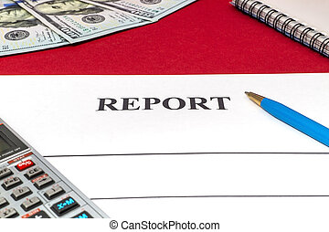 Report with pen, money and calculator on red table.