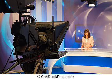 Reporter presenting news in TV studio - Focus on Camera