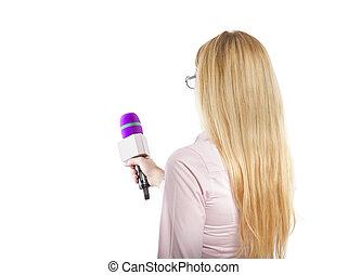 Reporter - Attractive blonde TV presenter holding a...