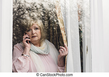Reporting A Crime - Senior woman is reporting a neighborhood...