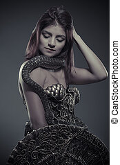 reptile, brunette woman posing with a python snake Australian
