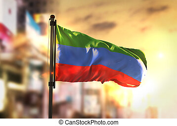 Republic of Dagestan Flag Against City Blurred Background At...