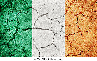 Republic of Ireland flag on dry earth ground texture background