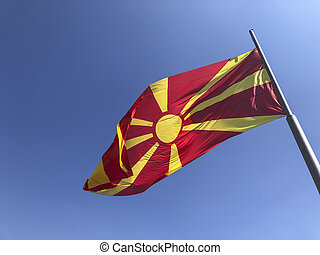 Republic of North Macedonia flag waving on sky