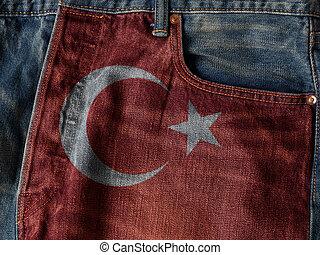 Republic of Turkey flag On Jeans Denim Texture. The concept of Republic of Turkey national flag on denim Jeans background. Ideal for Turkey Textile Industry Or Politics Concept.