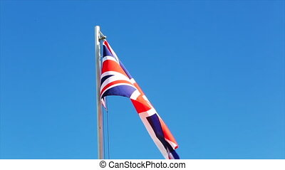 Request UK flag in front of blue sky