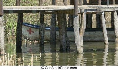 Rescue Boat near Wood Pontoon