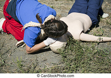 rescue breathing - CPR Practitioner Examining Airways on...