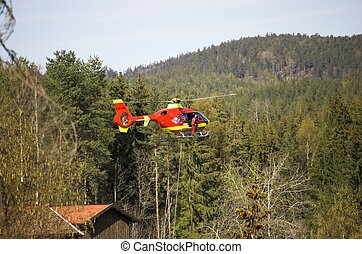 Rescue Chopper Hover - A red Norwegian State Air Ambulance...