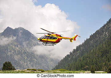 Rescue helicopter in the mountains - Red and yellow rescue...