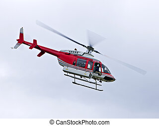 Rescue helicopter - Red rescue helicopter flying mission in...