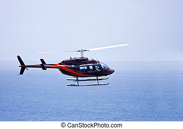 Rescue helicopter patrolling over the ocean