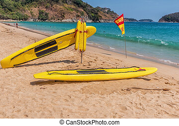 8d1d15c551f0 Life guard rescue surfboard sits on waimanalo beach with islands ...