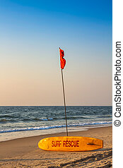 Rescue surfboard on the sand beach near the sea or ocean