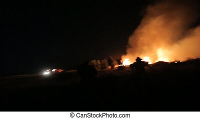 Rescue team arrived to extinguish the fire in a field at...