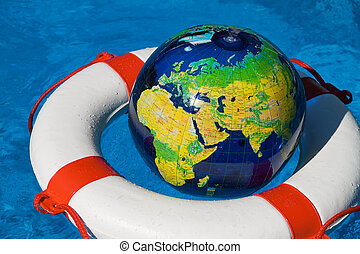 rescue tires in the pool - a rescue tire floating in a...