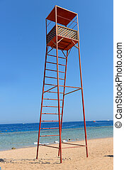 Rescue tower on the beach near the sea