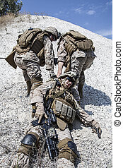 US marines evacuate the injured fellow in arms in the mountains