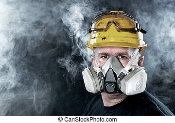 Rescue worker - A rescue worker wears a respirator in a...