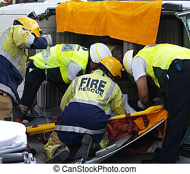 Rescuing the Driver - Ambulance & firemen working to remove ...