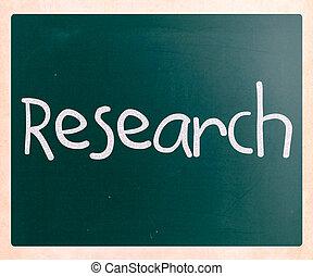 """Research"" handwritten with white chalk on a blackboard"
