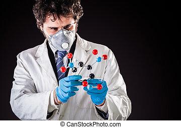 researcher examining a tnt molecule