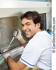 Researcher Filling Chemical In Testtube