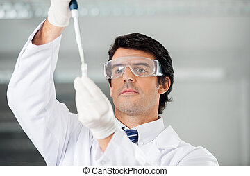 Researcher Filling Solution Into Test Tube