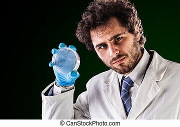 researcher holding an empty petri dish