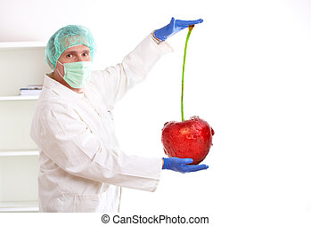 Researcher holding up a GMO fruit