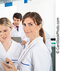 Researcher With Colleague In Laboratory