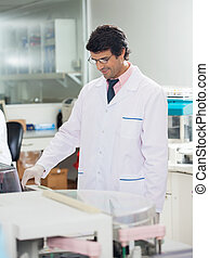 Researcher Working In Laboratory