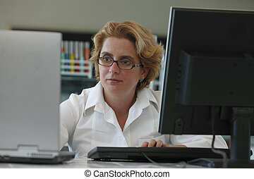 Researcher working on computers