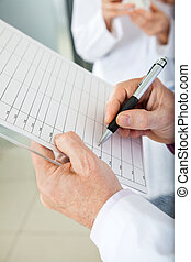 Researcher Writing On Clipboard