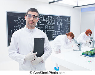 researchers in a chemistry lab