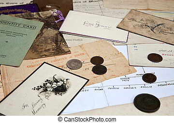 A collection of family documents and photographs being used to research the family tree