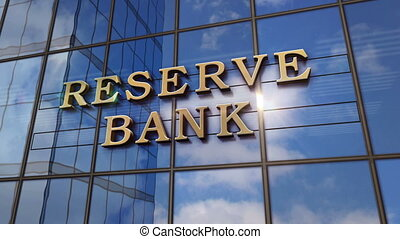Reserve Bank sign on glass building. Business, economy and public finance concept in 3D rendering animation. Mirrored sky and city on modern facade.