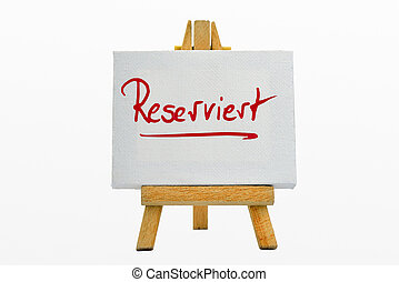 reserved - An easel with sign Reserviert/Reserved